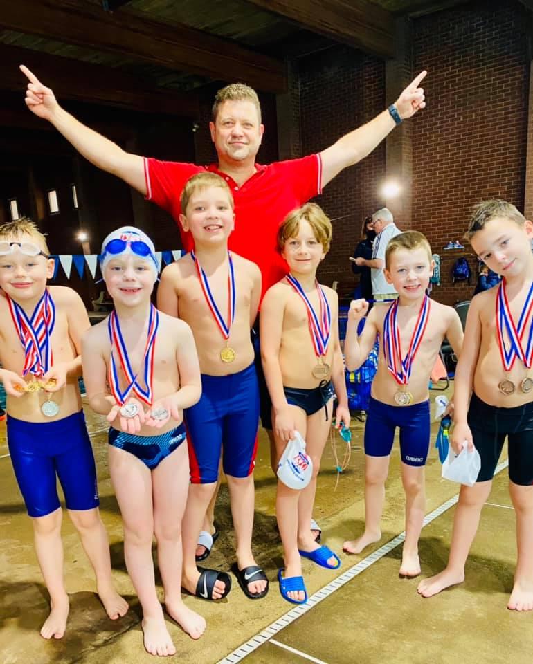 Rewarding of our BeFirst Swim Team Minies!